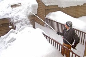 man shoveling snow denver co